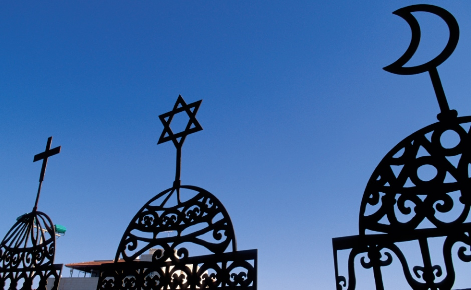Three Faith symbols The Cross, The Star of David and the Crescent Moon