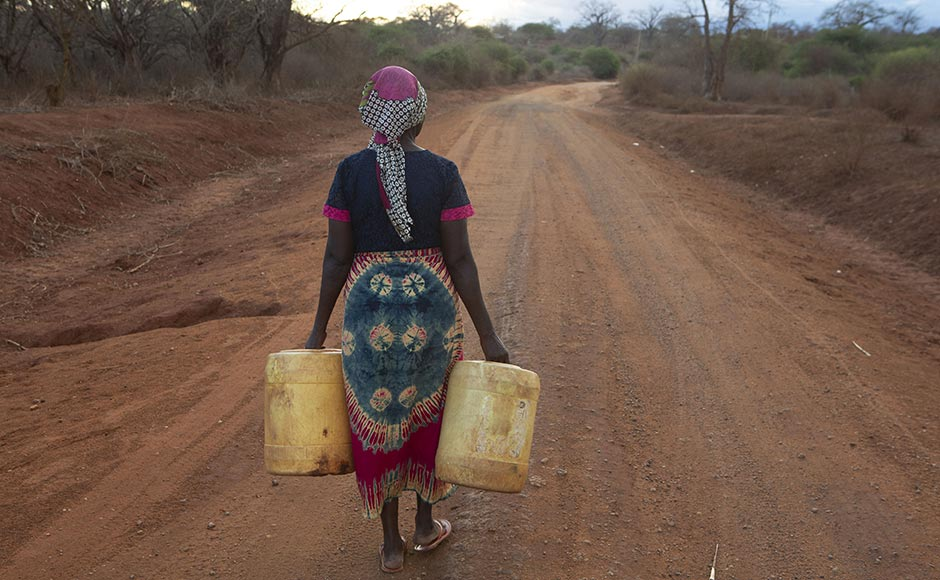 Grandmother Rose Katanu Jonathan, 68, of Kitui, Kenya, walks for six hours most days to collect water. Her nearest dam has dried up. Photo by Adam Finch/Christian Aid.