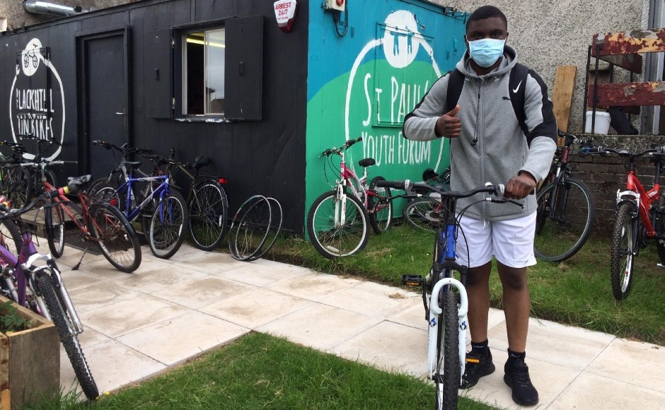 Young person outside the On Bikes site