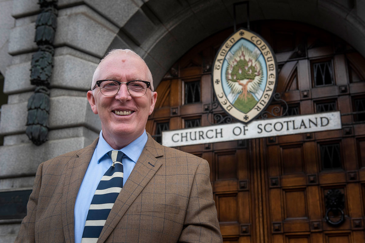 Martin Fair in front of the Church of Scotland's offices