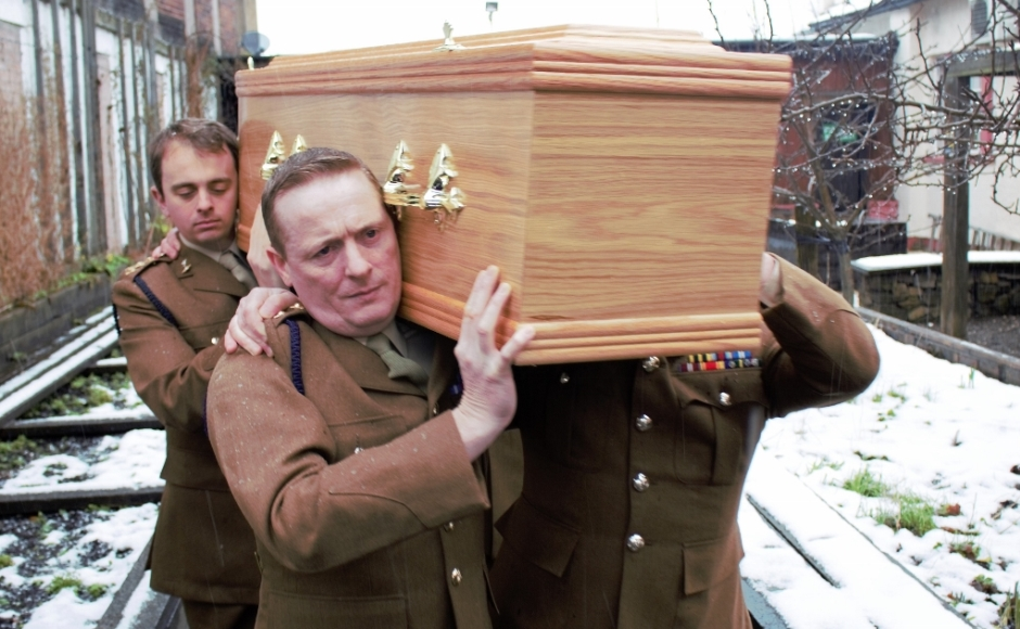 Servicemen from the 32nd Signal Regiment carried Mrs Wallace's coffin to her final resting place.