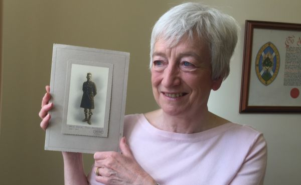 Mrs Barr holding photo of Pt David Wyllie