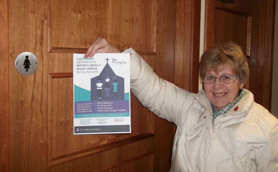 Brightons Parish Church putting the poster up