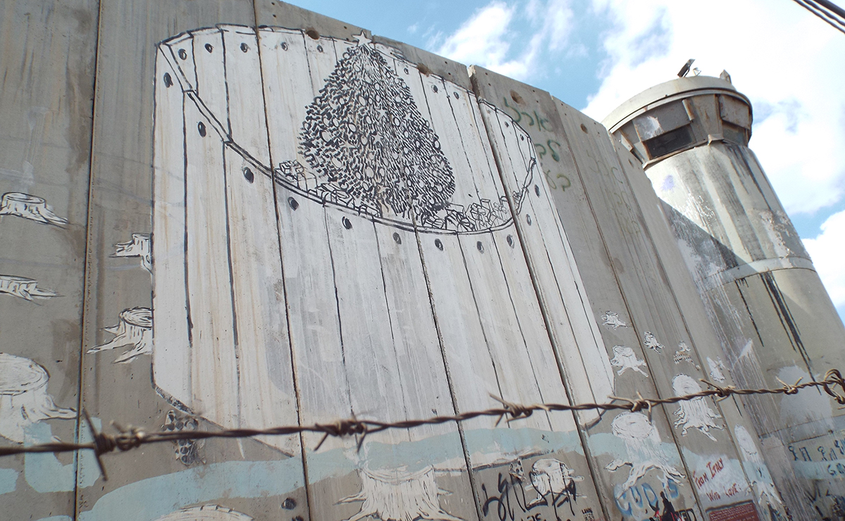A Christmas tree painted on Separation Wall in Bethlehem