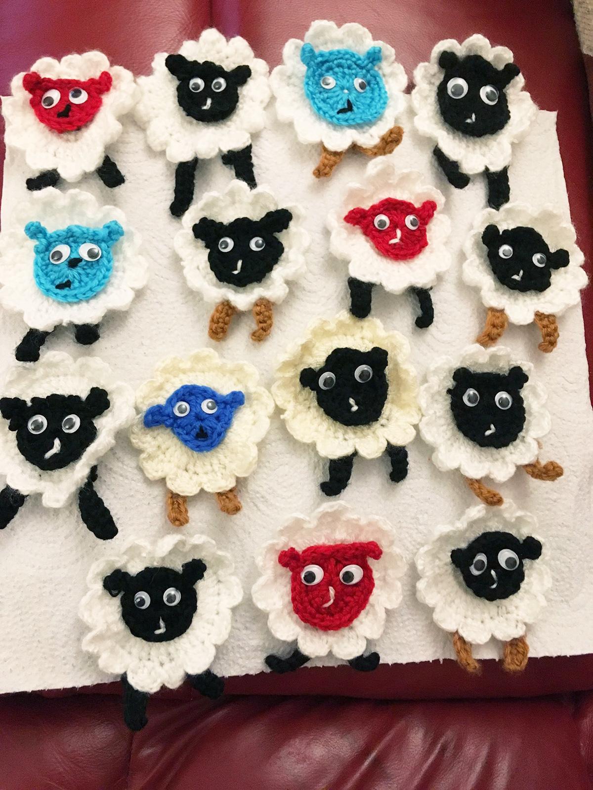 An array of crocheted sheep