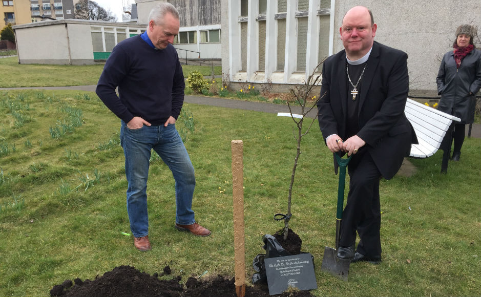 Rev Stephen  Ashley with the Moderator planting a pear tree