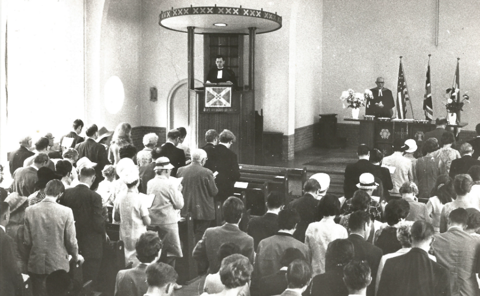Service in 1970 commemorating the 350th Anniversary of the Pilgrim Fathers departure from Holland. The person behind the Communion Table is Dr Eugene Carson Blake, General Secretary of the World Council of Churches, a prominent American Presbyterian Minister who too0k part in the march on Selma to end segregation and was prominent in the Civil Rights movement. Rev John Russell is preaching behind the pulpit.