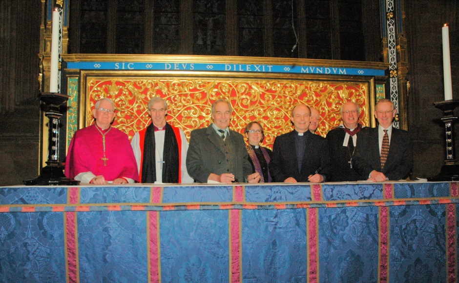 Partners and companions signing ecumenical agreement
