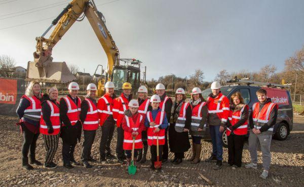 Members from Crossreach Portakabin Teachers and Local Schoolchildren prepare to break the ground on the new build