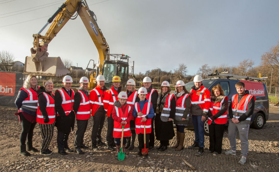 Members from Crossreach Portakabin Teachers and Local Schoolchildren prepare to break the ground on the new build