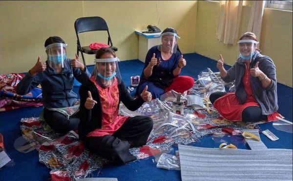 Nurse tutors in Nepal making protective visors