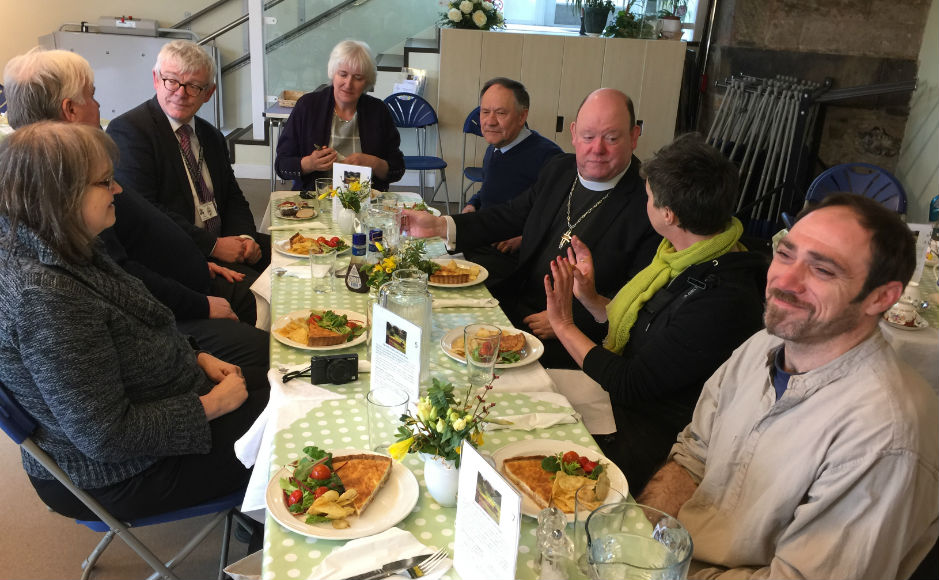 A group including the Moderator enjoying a meal