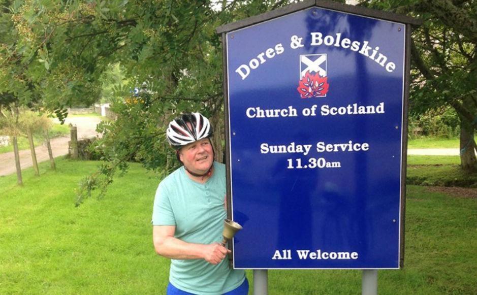 Rev Robert Brookes ringing a hand bell at Dores and Boleskine Church