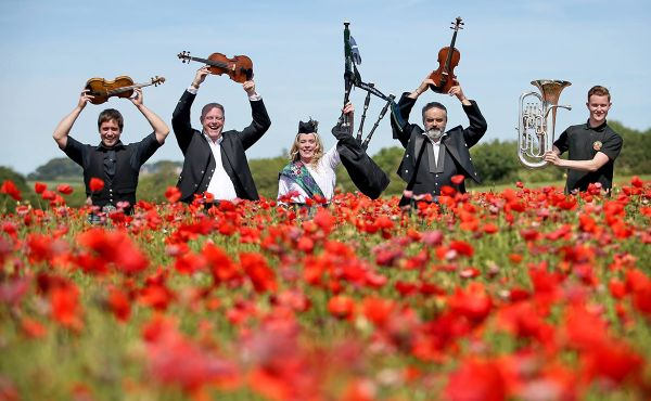Musicians in a field of poppies