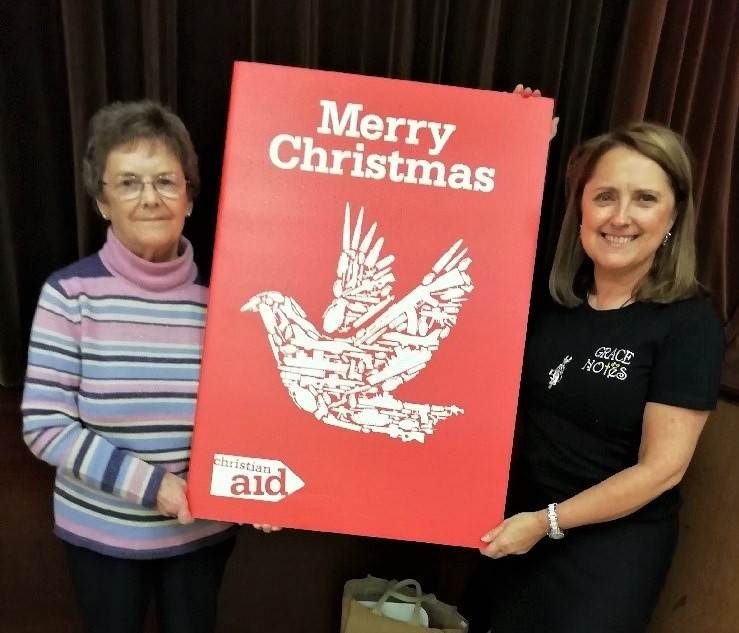 Iris Nelson and Janis McBride, members of St John's Parish Church, holding the card.
