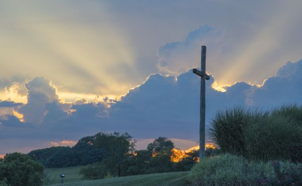 Cross on a hill infront of a sunset