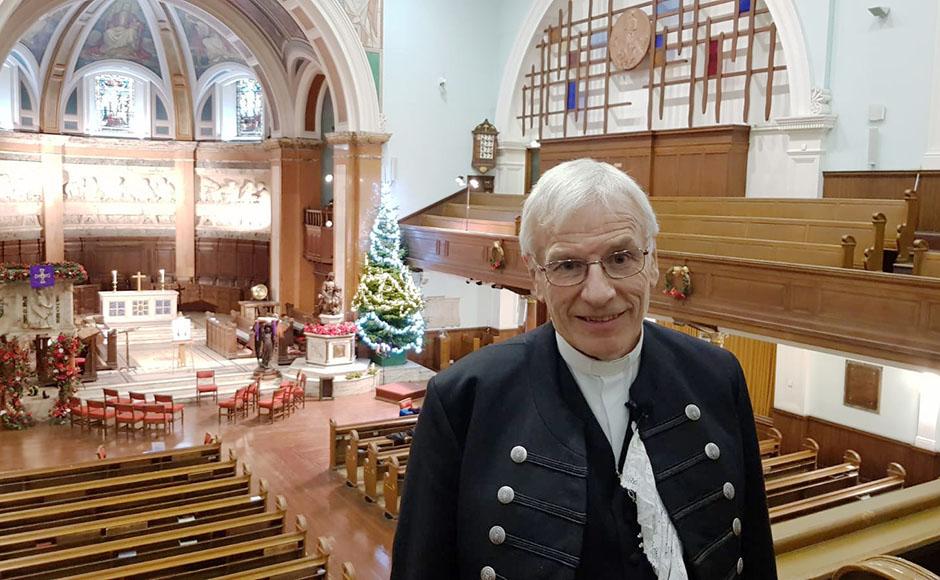 Rt Rev Colin Sinclair standing in St Cuthbert's Parish Church in Edinburgh