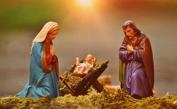 Figures of Mary and Joseph looking at Jesus in the manger