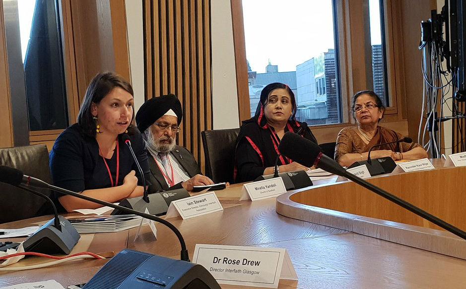 Inerfaith Officer Mirella Yandoli (left) at an event at the Scottish Parliament