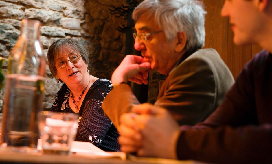 People in discussion around a table