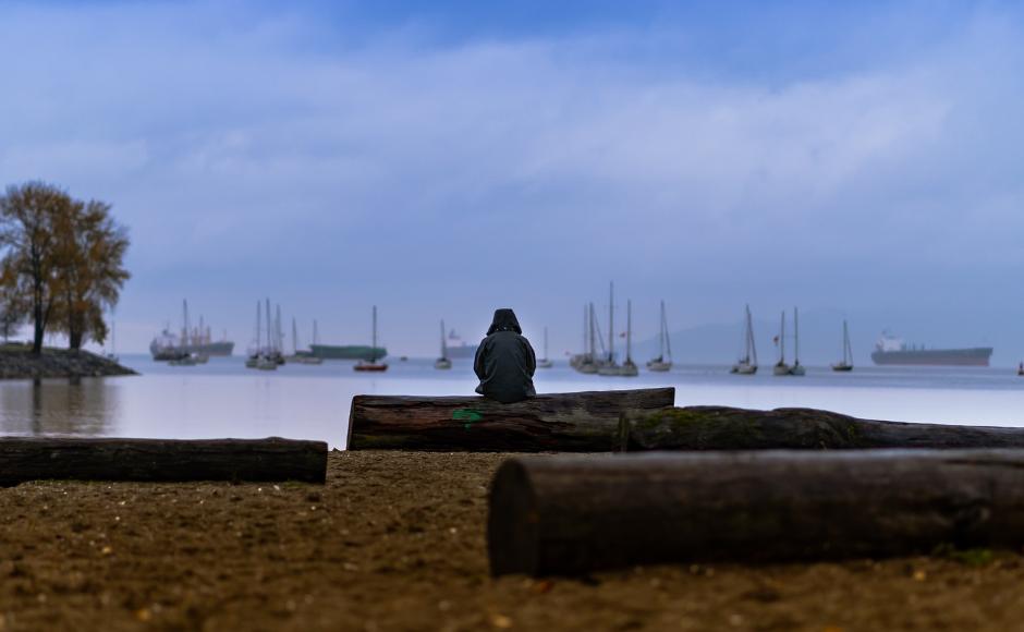 Woman sitting alone on a beach