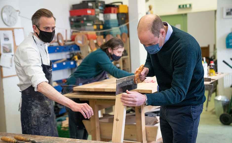 Prince William visiting the Grassmarket Community Project's workshop which makes furniture from recycled pews and other responsibly-resourced wood