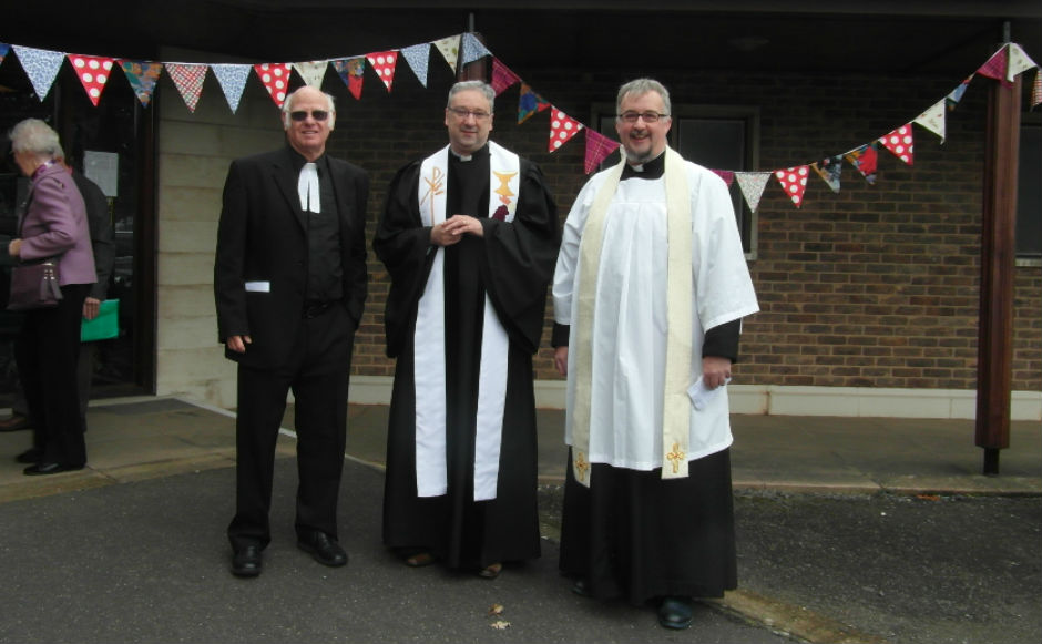 The minister of Corby St Ninians stood with a previous minister and  the vicar of the neighbouring church