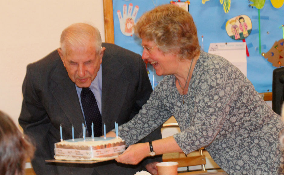 Dr Fraser blows out the candles on his cake