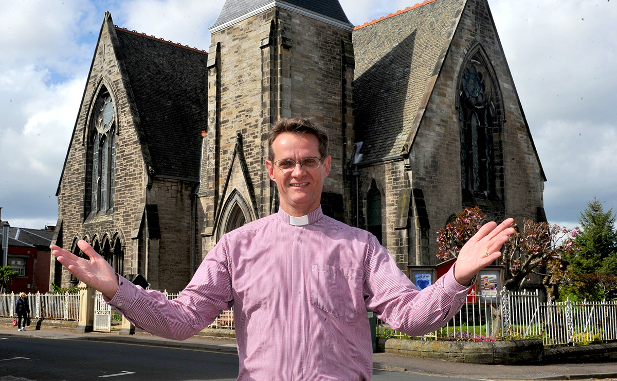 Rev Dr John Carswell of Cadzow Parish Church in front of his church