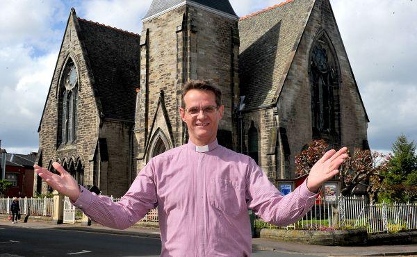 Rev Dr John Carswell of Cadzow Parish Church in front of his church