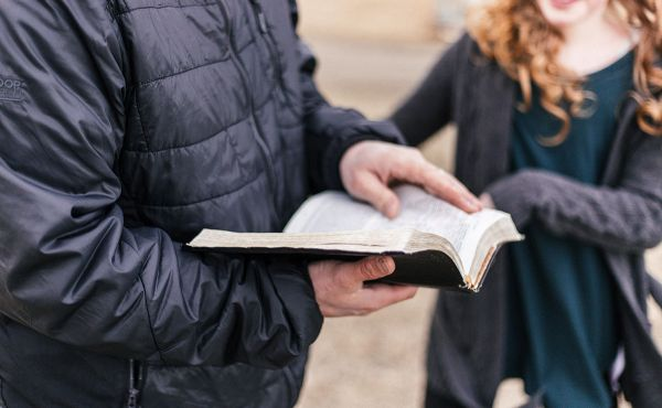 Man and woman discussing bible