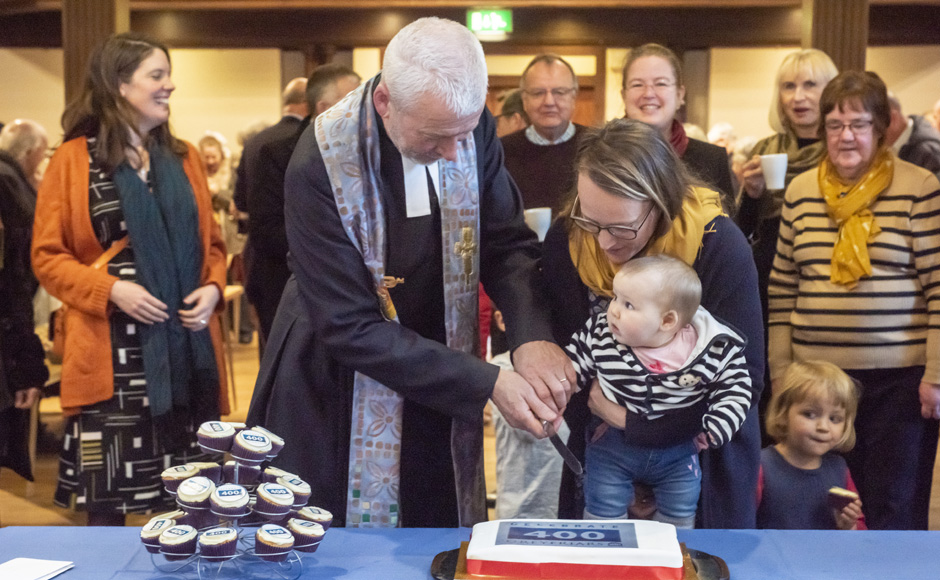 Rev Richard Frazer cutting a cake