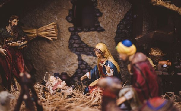 Nativity scene figurines looking at baby Jesus